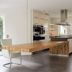 Every dining table created by the DESIGN brand is a distinctive one-off tailored to individual customer requirements. - It all started about 15 years ago, when brothers Gerhard and Dieter Nuss too… Kitchen Island Dining Table, Kitchen Benches, Kitchen Furniture, Kitchen Interior, Condo Decorating, Cuisines Design, New Living Room, Atrium, Kitchen Accessories