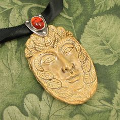 Khaki colored Green Man Pendant with Sterling and Amber Bail - OOAK by marybird on Etsy