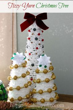 Christmas DIY | Tizzy Yarn Christmas Trees.  This is a super easy craft that is fun to put together and add next to your nativity!   happydealhappyday.com