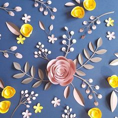 Pink and yellow paper flowers on blue background Kirigami, Deco Floral, Motif Floral, 3d Paper, Origami Paper, Diy Flowers, Paper Flowers, Paper Plants, Paper Magic