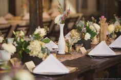 milk glass bud vases, wooden boxes with dusty miller, football mums and roses