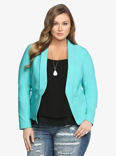 Oh, it's time to work it. This bright teal blazer surely brings a lively burst of color to your appearance. It has a trendy asymmetrical cut and flat front pockets for a sleek look. This chic style is modern enough to sport from the office to happy hour.