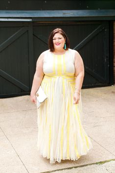 4a03e9e5daee6 A plus size maxi dress in shades of yellow and cream with tulle. See more