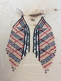 Name: Burberry Plaid Beaded Earrings Size: 5 1/2 inches long ( with hooks 1 1/2 inch wide Weight 3 oz per earring Colors: tan, black, white, red These earrings are my original design and hand woven by me; they are truly one-of-a-kind. I have put in many hours of work not only in the