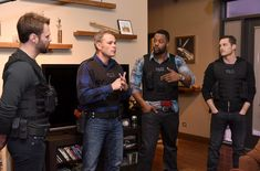 """Jesse Lee Soffer Photos Photos - Actor Patrick John Flueger, Chicago Police consultant Brian Luce, actors Laroyce Hawkins and actor Patrick John Flueger perform an on set demonstration of """"Chicago P.D."""" during the press junket for NBC's 'Chicago Fire', 'Chicago P.D.' and 'Chicago Med' at Cinespace Chicago Film Studios on November 9, 2015 in Chicago, Illinois. - NBC's 'Chicago Fire', 'Chicago P.D.' and 'Chicago Med' - Press Junket"""