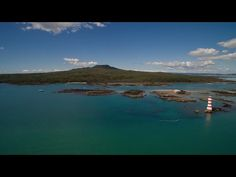Rangitoto Island sits majestically just off the Auckland coast, a short 25 minute cruise from downtown Auckland. Visible from Mission Bay to Cheltenham Beach. Mission Bay, Auckland, Coast, Skyline, River, Island, City, Beach, Cruises