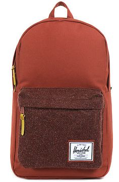 The Woodside Backpack in Rust  by Herschel Supply. Get a bag that's both functional and fashion forward this season  $70