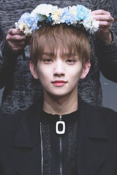 He looks like a prince from some drama and that they are crowning him (Joshua)