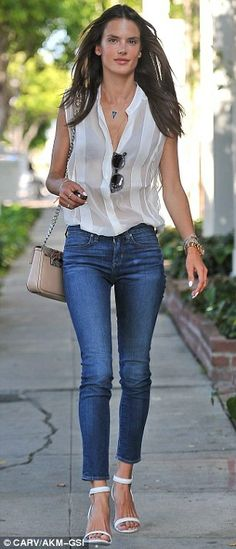 Alessandra Ambrosio in a white button-down and skinny cropped denims