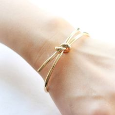 Knot Bangle / Love Knot bracelet, gold and silver by laonato on Etsy https://www.etsy.com/listing/228034216/knot-bangle-love-knot-bracelet-gold-and