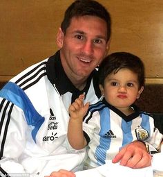 Family man: Messi poses with his young son during a family day party with Argentina ahead of the World Cup