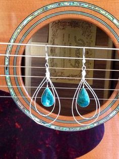 Elegant silver reused guitar string dangle earrings with a blue apatite natural stone in the center.  Come visit our online shop for more music inspired art-- jewelry, repurposed instruments, playable instruments, furniture, housewares, and art.  www.MusicAsArtBySarah.etsy.com