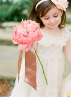 A single coral peony makes a perfect wand for a #flowergirl to carry down the aisle!
