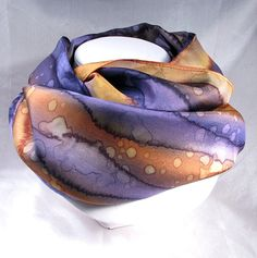 Quintessence Silk Art by Shauna Blake Hand painted silk scarf in shades of purple and copper.    Features one of my signature patterns.    The scarf measures approximately 8x 54