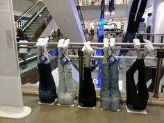 Selfridges in London doesn't want you to miss their denim department- they had displays not only on shop windows but also near escalators and the atrium.