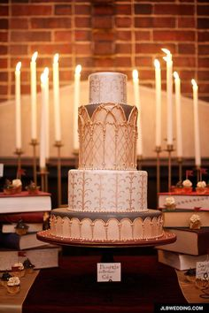 Love this, it's so pretty and geeky. lol Pumpkin and butterbeer flavored Harry Potter wedding cake inspired by Hogwarts architecture - Holy Triwizard cup, Hagrid!