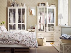 """Laundry-friendly bedroom"" inspiration from Ikea. BIRKELAND Wardrobe.     Putting the laundry away is easy with a well-organized wardrobe, chest of drawers, hooks and small storage solutions."