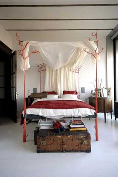 tree branch four poster bed.