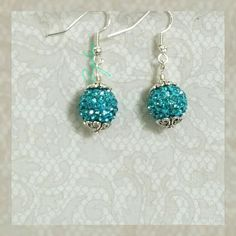 Aqua blue crystal drop earrings Handmade with austrian crystal pavers on ss hooks. Consider bundling with another item for a discount. Salty Grace  Jewelry Earrings