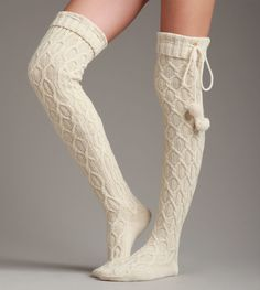 Add a little shimmer to your lounge look with this glittering pair of thigh-high socks. Made from a soft cable knit and detailed with pompom-finished tie, this style looks sweet next to a roaring fire.