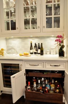 Bar Ideas. Bar Cabinet Design. Custom pullouts were designed to hold liquor bottles upright, with adjustable dividers to keep them from tipping. #Bar