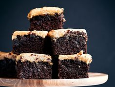 The best healthy paleo coconut flour brownies topped with smooth and creamy peanut butter frosting. Easy gluten free brownie recipe!