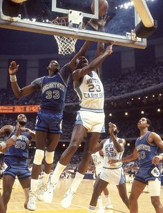 UNC's Michael Jordan squeezes a shot over Georgetown's Patrick Ewing during the 1982 NCAA Championship in New Orleans. Jordan, a freshman, would drain the game-winning jumper with 17 seconds left to secure the national championship for the Tar Heels. Michael Jordan Unc, Michael Jordan Photos, Michael Jordan Basketball, Kentucky Basketball, College Basketball, Basketball Players, Duke Basketball, Kentucky Wildcats, Basketball Jones