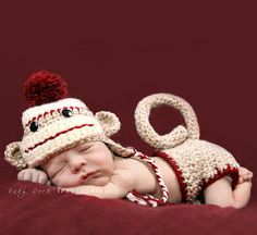I want one of these so bad, but just plain brown colors.  Boy Sock Monkey Hat and Diaper Cover Set-boy sock monkey hat and diaper cover.