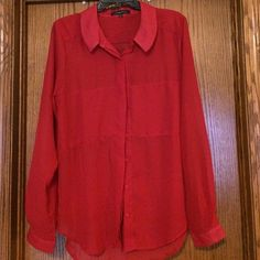 Long sleeved blouse Button down long sleeved red blouse. 100% polyester. Sheer material. Wildflower Tops Button Down Shirts