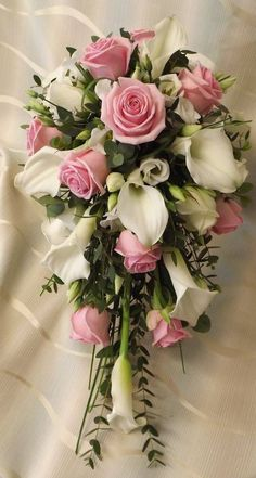 Gorgeous Pink Rose and Calla Lily Bouquet We Hope you enjoy looking at our Shower bouquet styles, we have a very large collection! All our bouquets are individually designed for the brides exact scheme and measurements, which is the most. Lily Bouquet Wedding, Cascading Wedding Bouquets, Calla Lily Bouquet, Bride Bouquets, Bridal Flowers, Floral Bouquets, Calla Lilies, Floral Wedding, Rose And Lily Bouquet