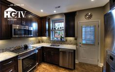 """Check out the """"wood-look"""" ceramic tile!  And that gorgeous glass tile backsplash...   Synergy D&C, Reston, VA"""