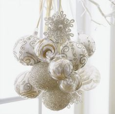 Gather pretty ornaments and dangle them from various lengths of ribbon to make festive Christmas decor. Hang them near a window, over a table, etc....