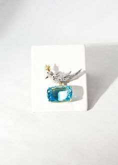 "Aquamarine and diamond ""Bird on a Rock"" brooch, by Jean Schlumberger, Tiffany & Co. Designed as a pave-set diamond bird perched on a cushion-cut 48 carat (weight is approximate) aquamarine, mounted in 18KT gold. Signed Tiffany & Co., Schlumberger."