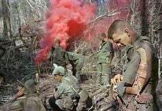 Soldiers of the 173rd Airborne Brigade set off a smoke grenade in the jungle during Operation Silver City in Long Khanh Province, Vietnam, in March of 1966.