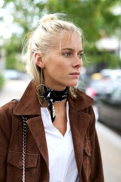 Those scandi-style drop earrings paired with a knotted neckerchief are proof that accessories are enough to make any outfit.