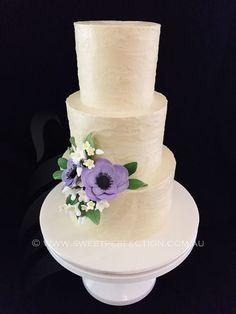 Buttercream textured wedding cake with custom sugar flowers.