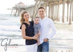 Family Portrait Session at the beach - Huntington Beach Photographer, Big Family, Gorgeous Family, Beach, Ocean, Pier, CA, Cali, California, Huntington Beach, Sand, Sea, Water, Beautiful Day, Grandparents, Daughters, Sisters, Grandchildren, Babies, Toddlers, Navy Blue, White, Mom, Dad, Baby Boy, Precious Family, Beautiful People, Gold Chain Necklace, Nice Smiles  GilmoreStudios.com