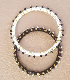 A set of Two Black, White and Gold Bangles by KalaaStudio on Etsy