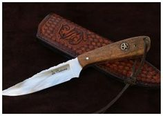 """Cabrera knives - BCHGMW Blade: 5/32"""" D2 Steel Hardened  Cryo Treated to 60 RC. Blade 4"""" ,OAL 8 7/8"""" Handle: Stabilized Mesquite Wood Burl w/ Brass Pins and Star Concho Inlay Thong Hole: Brass Tube Vine File work on the Spine, Custom leather Sheath"""