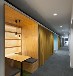Meetings Rooms >> Open Meeting Space >> This cool meeting booth at Rackpace is a great informal meeting point for colleagues to work from. The bespoke joinery creates a completely wooden #meetingbooth, and provides a biophilic element to the #officedesign which helps to boost #wellbeing. This is a small space that utilises #bespokecarpentry to maximise the space. Exposed lightbulbs help to provide a rustic feel to this office space. Click to see more of this #Cooltechfirm 's #LondonOffice...