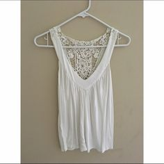 White crochet back tank top White tank top with beautiful crochet back. Can wear up or down and is super soft and comfy. No flaws. Ask me any questions. Want everything gone so make me an offer! Express Tops Tank Tops