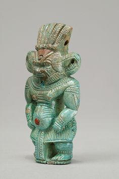 Bes figure Period: New Kingdom Dynasty: Dynasty 18 Date: ca. 1550–1295 B.C. Geography: From Egypt, Northern Upper Egypt, Abydos, Cemetery D, Tomb D14 E, Egypt Exploration Fund excavations, 1900 Medium: Faience, paste inlay Dimensions: H. 7.9 × W. 4.3 × D. 2.6 cm (3 1/8 × 1 11/16 × 1 in.) Credit Line: Gift of Egypt Exploration Fund, 1900 Accession Number: 00.4.33