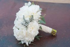White peony bouquet with dusty miller and seeded eucalyptus   Floral Design by Sugar Branch Events www.sugarbranchevents.com   Stephanie Ann Photography