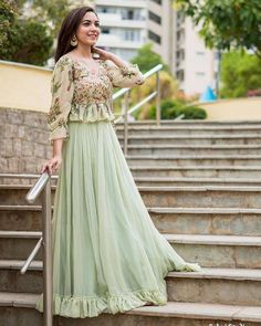 The stunning Ritu Varma looking flawless in Mrunalini Rao . Beautiful pista green color lehenga and peplum top with floret lata design hand embroidery thread work. Designer Party Wear Dresses, Kurti Designs Party Wear, Indian Designer Outfits, Indian Outfits, Lehenga Choli Designs, Long Gown Dress, Lehnga Dress, Indian Lehenga, Stylish Dresses