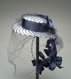 Circa 1943 hat, via The Meadow Brook Hall Historic Costume Collection.