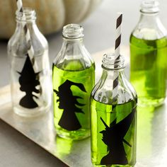 "Witch Silhouette Drink Bottles: ""Give plain glass jars and bottles a wicked-cool update for Halloween with these witch silhouettes. Print our witch patterns, available below, onto white paper, enlarging or reducing as needed to fit your drink bottles or glasses; cut out to use as templates. Trace around the templates onto black self-sticking shelf liner; cut out. Peel off the paper backing and adhere the silhouettes to your drink bottles."" FREE PATTERNS ON WEBSITE."