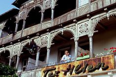 A man stands on the balcony of a rundown old villa in Sellin on Rügen.     Read...