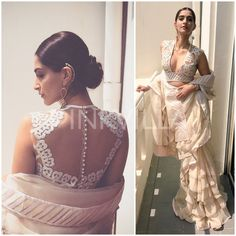 Sonam Kapoor in a tiered ruffle saree by design duo Abu Jani Sandeep Khosla, and styled it with dangling Suhani Pittie earrings and Bulgari watch.