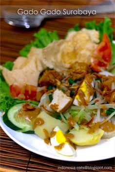 """Gado-gado is one of the well-known dishes from Indonesia. Gado-gado literally means """"mix mix"""" since gado-gado is the plural word of gado, so gado-gado means mixes. In Indonesia, gado-gado is not a salad dish group, it is a one dish meal… Easy Asian Recipes, Easy Delicious Recipes, Yummy Food, Malaysian Cuisine, Malaysian Food, Malaysian Recipes, Gado Gado Recipe, Indonesian Cuisine, Indonesian Recipes"""