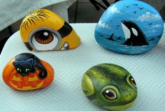 beautiful painted rocks - frog, whales, black cat on pumpkin